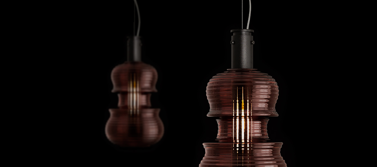 Light 'n' Roll by Sergi Ventura - Two Light and Roll lamps in red stradivarius suspended on the ceiling